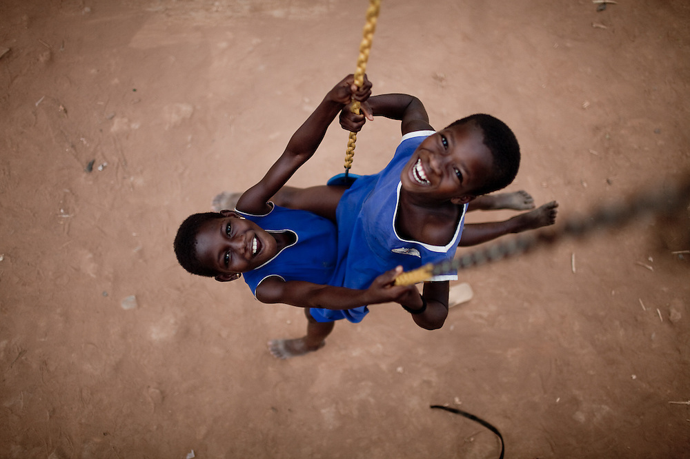 Playing on a swingset at an all-girls school run by FAWE in Obodan, Ghana.
