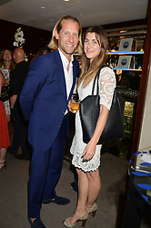 The UK Premier of Johnnie Walker Blue Label's 'Gentleman's Wager' - a short film starring Jude Law was held at The Bulgari Hotel & Residences, 171 Knightsbridge, London on 22nd July 2014.<br /> Picture Shows:-JAKE PARKINSON-SMITH and IZZY LAWRENCE.