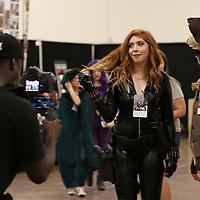 Ronnie Moore Jr. of Akioboy takes videos of cosplayers Saturday at Tupelo Comic Con