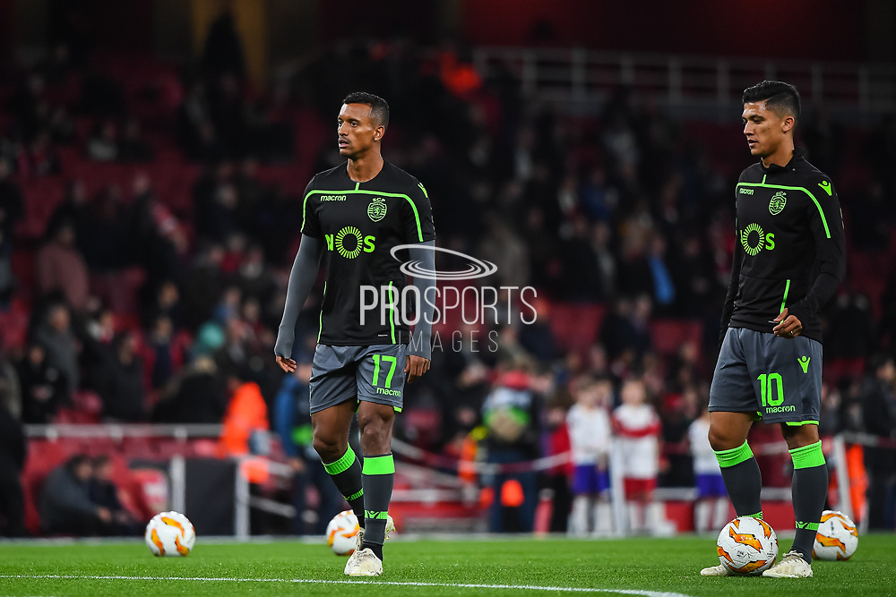 Sporting Lisbon Forward Nani (17) and Sporting Lisbon Forward Fredy Montero (10) warm-up ahead of the Europa League group stage match between Arsenal and Sporting Lisbon at the Emirates Stadium, London, England on 8 November 2018.