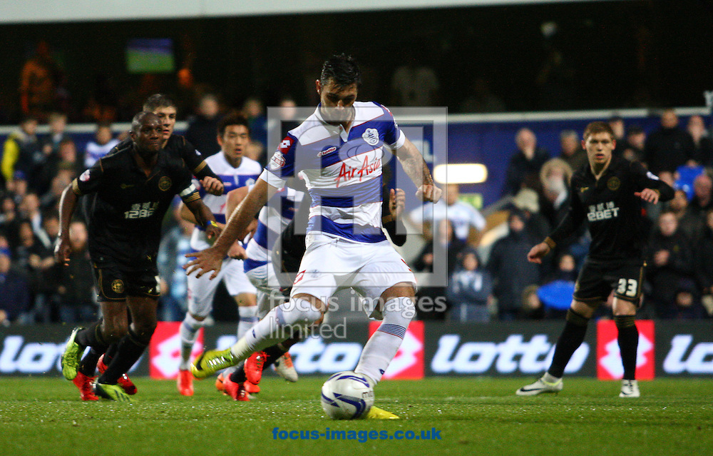 Charlie Austin of Queens Park Rangers scores a penalty to equalise during the Sky Bet Championship play off semi final second leg at the Loftus Road Stadium, London<br /> Picture by Rob Fisher/Focus Images Ltd +44 7450 945824<br /> 12/05/2014