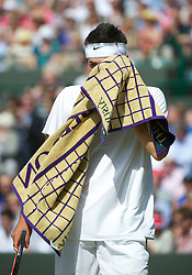 LONDON, ENGLAND - Wednesday, June 29, 2011: Bernard Tomic (AUS) in action during the Gentlemen's Singles Quarter-Final match on day nine of the Wimbledon Lawn Tennis Championships at the All England Lawn Tennis and Croquet Club. (Pic by David Rawcliffe/Propaganda)