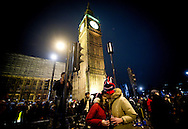 A couple is kising during the celebrations of the New Year in Westminster, near Big Ben, in London. BOGDAN MARAN 1989 / BIG PICTURES