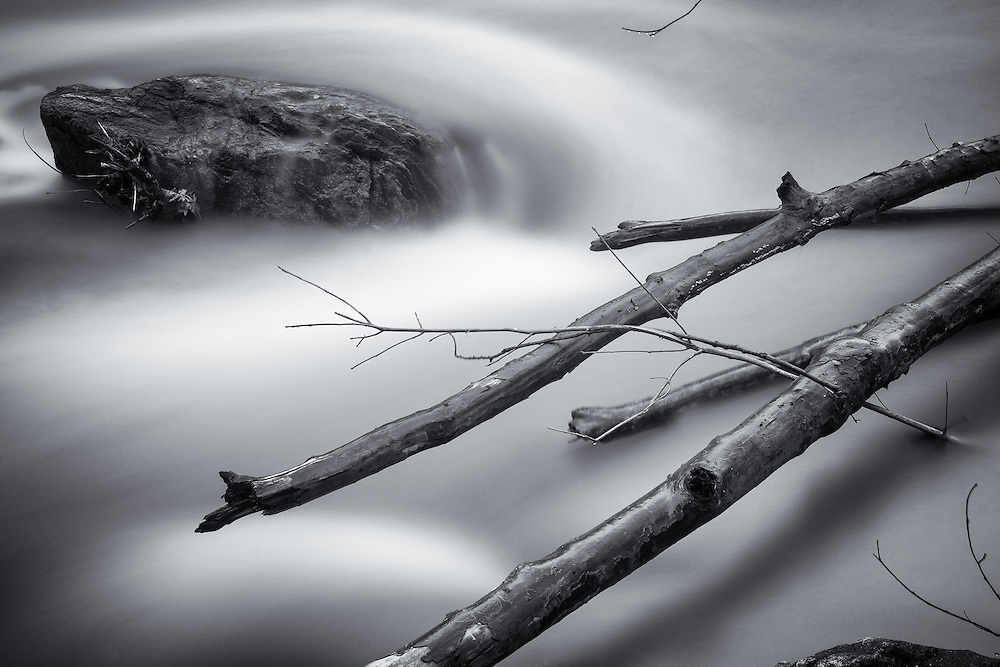 A long exposure black and white photograph of the Patapsco River at Oella, Maryland.