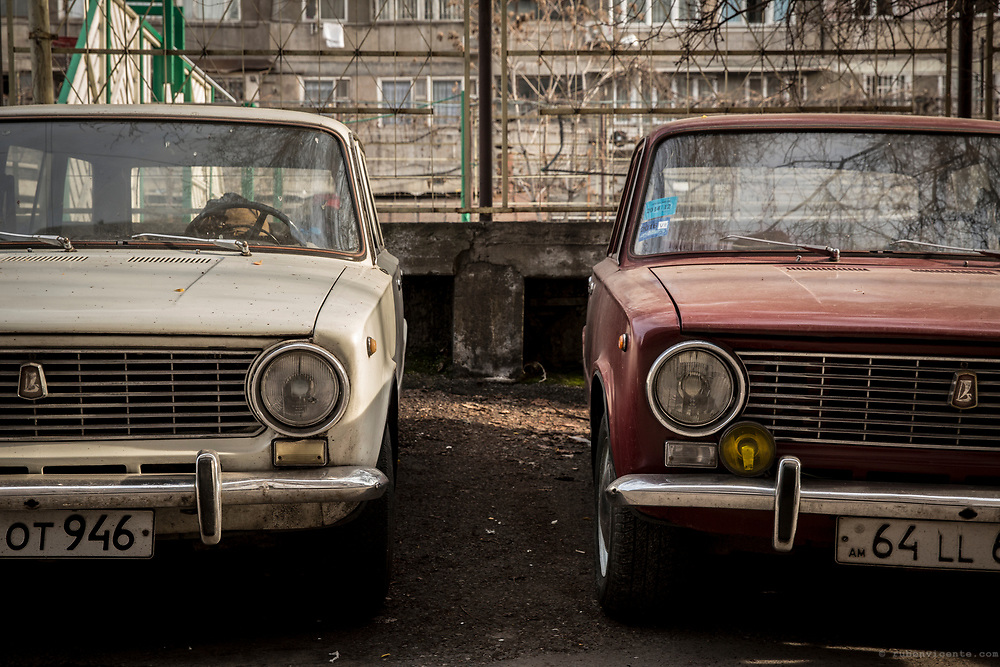 Red and white Lada cars parked in Yerevan. Armenia