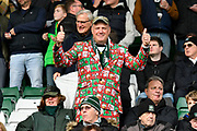 A Plymouth Argyle fan wearing a festive wrapping paper patterned suit in the stand gives the thumbs up before the EFL Sky Bet League 1 match between Plymouth Argyle and Accrington Stanley at Home Park, Plymouth, England on 22 December 2018.