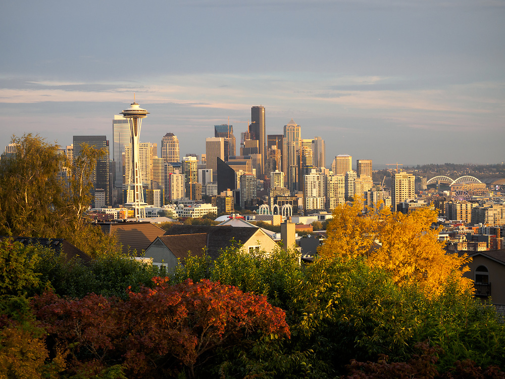 United States, Washington, Seattle. View of downtown Seattle from Queen Anne hill, including the Space Needle on the left, Columbia Tower in the center, and Century Link Field and the Seattle Great Wheel on the right.