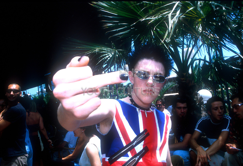 YOUNG PUNK FLIPPING THE BIRD AT SPACE IBIZA