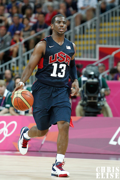 04 August 2012: USA Chris Paul brings the ball upcourt during 99-94 Team USA victory over Team Lithuania, during the men's basketball preliminary, at the Basketball Arena, in London, Great Britain.