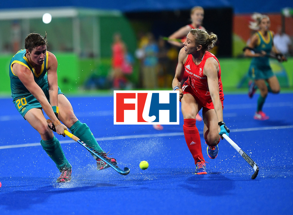 Australia's Kathryn Slattery hits the ball past Britain's Kate Richardson-Walsh during the women's field hockey Britain vs Australia match of the Rio 2016 Olympics Games at the Olympic Hockey Centre in Rio de Janeiro on August, 6 2016. / AFP / Carl DE SOUZA        (Photo credit should read CARL DE SOUZA/AFP/Getty Images)