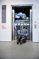 Repairman works on an elevator shaft