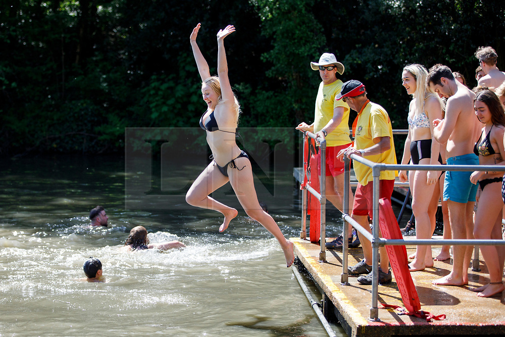 © Licensed to London News Pictures. 07/05/2018. London, UK. Brittany Rankin swims in Hampstead Heath Mixed Bathing Pond in north London as temperatures hit 28C on the hottest May bank holiday since 1999 on Monday, May 7, 2018. Photo credit: Tolga Akmen/LNP