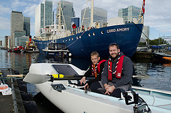 © Licensed to London News Pictures. 11/10/2014. London, UK. [NB STRICT EMBARGO - no use until 00:01 12/10/14 ]Making a splash: Scout volunteer living with epilepsy, Ashley Wilson (L), and Scout Ambassador and adventurer James Ketchell, test their specially designed 'Nothing's Impossible' boat for the first time in the docks around London's Canary Wharf. Photo credit : Ian Homer/LNP