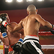 Joshua Santos (R) punches Ricky Tomlinson during a Telemundo Boxeo boxing match at the A La Carte Pavilion on Friday,  March 13, 2015 in Tampa, Florida.  Santos won the bout after Tomlinson's corner stopped the fight in the first round. (AP Photo/Alex Menendez)