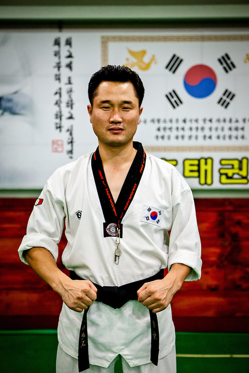Portrait of a teacher for Taekwondo at a school for children in Daegu. Taekwondo is a Korean martial art and the national sport of South Korea.