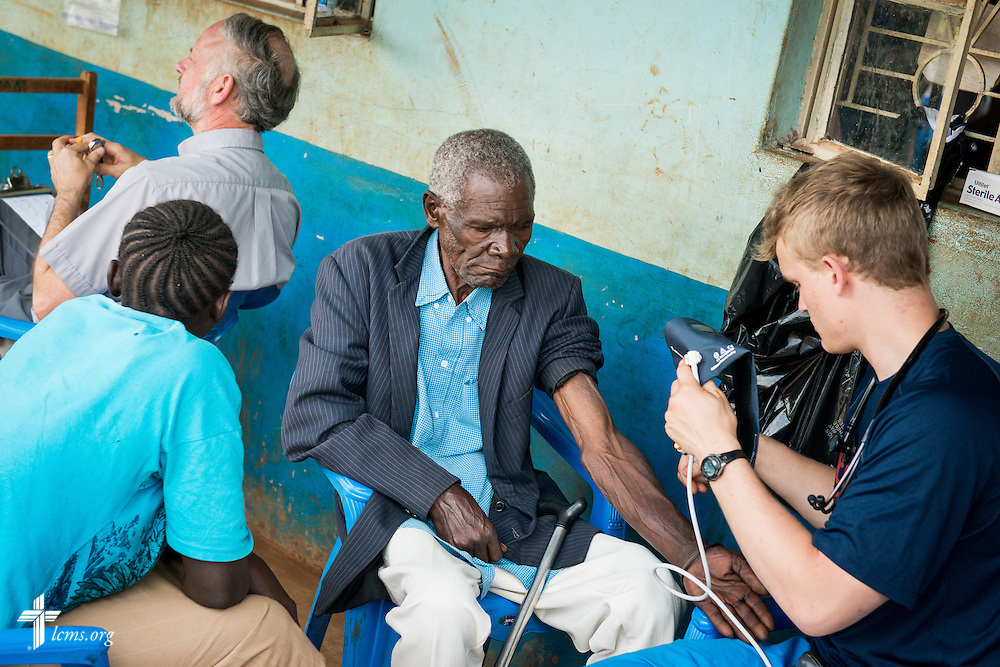 Kyle Uhlig checks vitals during a Mercy Medical Team clinic Wednesday, June 11, 2014, at the Luanda Doho Primary School in Kakmega County, Kenya. LCMS Communications/Erik M. Lunsford