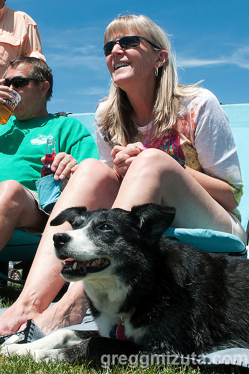 Mike and Arlene Barrie and Keeah watch beach volleyball at the  Payette River Games on June 21, 2014.