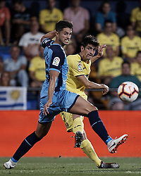 August 31, 2018 - Vila-Real, Castellon, Spain - Gerard (L) of Villarreal CF kicks the ball next to Juan Pedro Ramirez Lopez Juanpe of Girona FC during the La Liga match between Villarreal CF and Girona FC at Estadio de la Ceramica on August 31, 2018 in Vila-real, Spain  (Credit Image: © David Aliaga/NurPhoto/ZUMA Press)