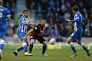 Queens Park Rangers striker Conor Washington (9) and Brighton central defender, Connor Goldson (17) during the Sky Bet Championship match between Brighton and Hove Albion and Queens Park Rangers at the American Express Community Stadium, Brighton and Hove, England on 19 April 2016.