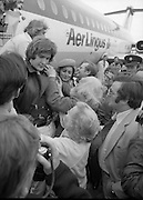 Johnny Logan on his return at Dublin Airport from Holland where he won the Eurovision Song Contest for Ireland with his entry What's Another Year..1980-04-21.21st April 1980.21-04-1980.04-21-80..Photographed at Dublin Airport..Johnny Logan being greeted by fans. Shay Healy is just behind him.