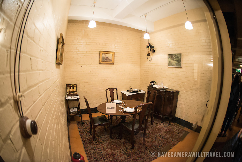The Prime Minister's dining room at the Churchill War Rooms in London. The museum, one of five branches of the Imerial War Museums, preserves the World War II underground command bunker used by British Prime Minister Winston Churchill. Its cramped quarters were constructed from a converting a storage basement in the Treasury Building in Whitehall, London. Being underground, and under an unusually sturdy building, the Cabinet War Rooms were afforded some protection from the bombs falling above during the Blitz.