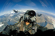 """A USAF Lockheed Martin F-16D """"Viper"""" pilot climbs into the wild blue yonder, flanked by a pair of playmates.  The aircraft is from the California Air National Guard, 144th Fighter Wing/194th Fighter Squadron, 83-183."""