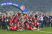 Portugal players celebrate winning the trophy during the Euro 2016 final between Portugal and France at Stade de France, Saint-Denis, Paris, France on 10 July 2016. Photo by Phil Duncan.