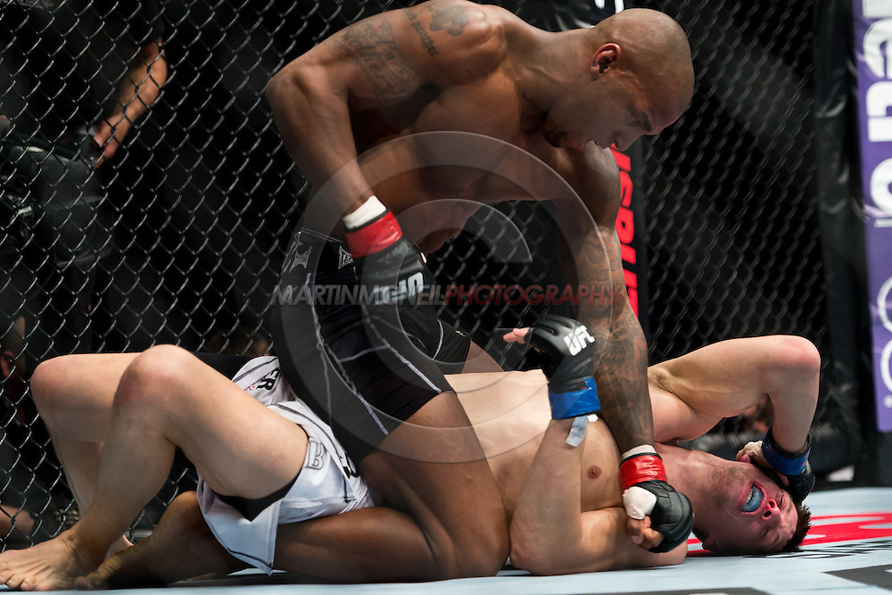 "STOCKHOLM, SWEDEN, APRIL 14: Francis Carmont (black shorts) and Magnus Cedenblad (white shorts) during ""UFC on Fuel TV: Gustafsson vs. Silva"" inside the Ericsson Globe Arena in Stockholm, Sweden"
