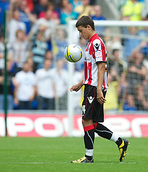 CARDIFF, WALES - Sunday, August 8, 2010: Sheffield United's Matthew Lowton walks off after being shown the red card during the League Championship match against Cardiff City at the Cardiff City Stadium. (Pic by: David Rawcliffe/Propaganda)