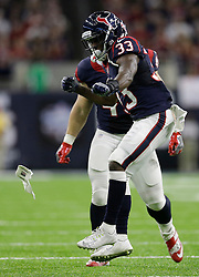 Houston Texans running back Akeem Hunt (33) celebrates after making a play against the Cincinnati Bengals during the first half of an NFL football game Saturday, Dec. 24, 2016, in Houston. (AP Photo/Sam Craft)