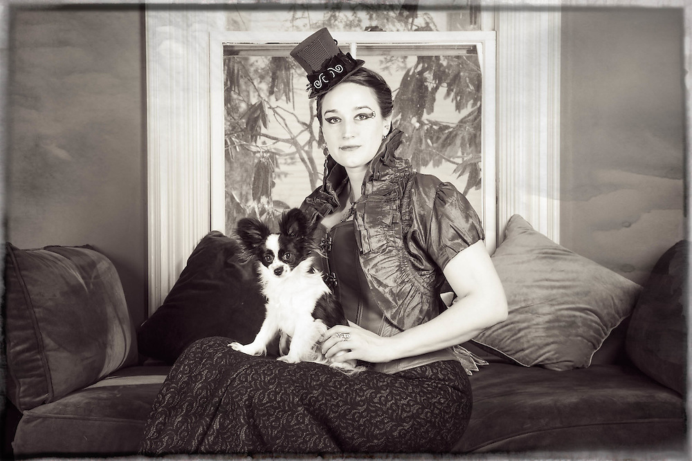 Steampunk style photo of woman with her Pomeranian dog.