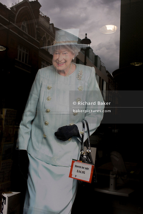 A life-size cardboard cut-out of Queen Elizabeth stands in a print business window in central London, ahead of a weekend of nationwide celebrations for the monarch's Diamond Jubilee. A few months before the Olympics come to London, a multi-cultural UK is gearing up for a weekend and summer of pomp and patriotic fervour as their monarch celebrates 60 years on the throne and across Britain, flags and Union Jack bunting adorn towns and villages.