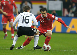 FRANKFURT, GERMANY - Wednesday, November 21, 2007: Wales' Simon Davies and Germany's Philipp Lahm during the final UEFA Euro 2008 Qualifying Group D match at the Commerzbank Arena. (Pic by David Rawcliffe/Propaganda)