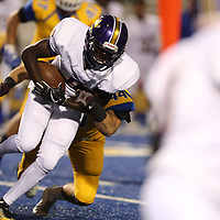 Columbus running back Michello Garrick II, is stopped by Tupelo's Jett Johnson in the first quarter.