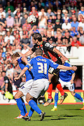Yann Kermorgant wins the ball from Michael Morrison and Paul Caddis during the Sky Bet Championship match between Bournemouth and Birmingham City at the Goldsands Stadium, Bournemouth, England on 6 April 2015. Photo by Adam Rivers.