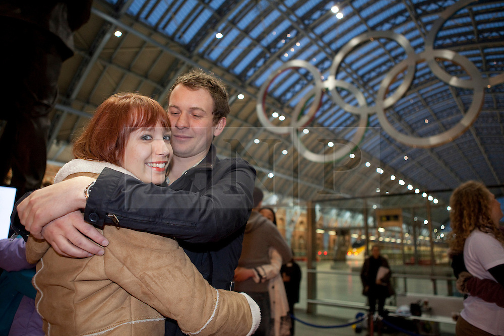 © Licensed to London News Pictures. 19/01/2012. London, U.K. Amy Hewis and boyfriend Matt Clark take part in  world's Longest marathon hug attempt at St. Pancras station, London on January 19th, 2012. Competitors are attempting to break the Guinness World Record for the world's Longest hug. Photo credit : Rich Bowen/LNP