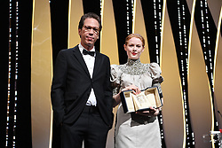 """British actress Emily Beecham (R) poses next to French actor Reda Kateb on stage after she was awarded with the Best Actress Prize for her part in """"Little Joe"""" on May 25, 2019 during the closing ceremony of the 72nd edition of the Cannes Film Festival in Cannes, southern France. Photo by David Niviere/ABACAPRESS.COM"""