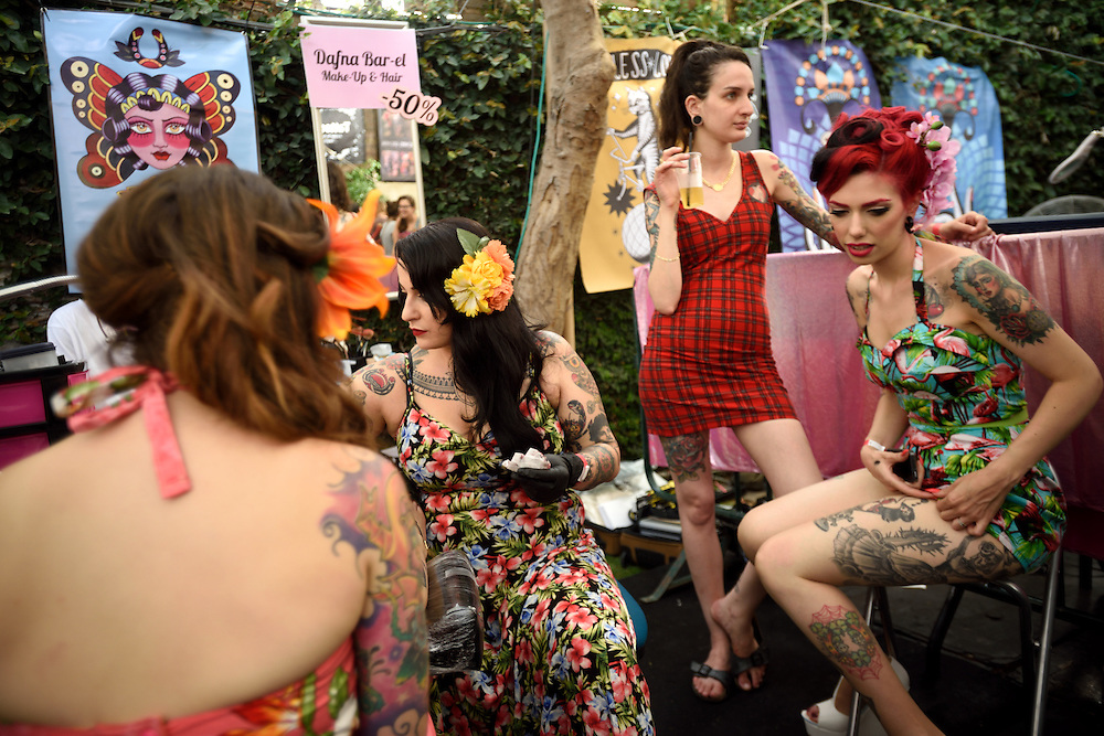 TEL-AVIV, ISRAEL - June 06, 2015: Israeli women are seen in a tattooing stand during the 3rd annual tattoo convention in Tel-Aviv on June 6, 2015.The Convention hosted Israeli and international tattoo and piercing artisits. Photo by Gili Yaari
