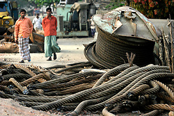 BANGLADESH MADHOM BIBIR HAT 6MARB05 - Labourers sort steel and electrical cables at one of the many secondary businesses selling hardware recovered from shipbreaking yards at Badhom Bibir Hat outside Chittagong, Bangladesh. ..jre/Photo by Jiri Rezac..© Jiri Rezac 2005..Contact: +44 (0) 7050 110 417.Mobile: +44 (0) 7801 337 683.Office: +44 (0) 20 8968 9635..Email: jiri@jirirezac.com.Web: www.jirirezac.com..© All images Jiri Rezac 2005 - All rights reserved.