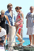 18.JULY.2011. SAINT TROPEZ<br /> <br /> CATHERINE ZETA-JONES JUMP IN A BOAT, WITH HER HUSBAND MICHAEL DGOULAS AND JON BON JOVI IN SAINT TROPEZ. <br /> <br /> BYLINE: EDBIMAGEARCHIVE.COM<br /> <br /> *THIS IMAGE IS STRICTLY FOR UK NEWSPAPERS AND MAGAZINES ONLY*<br /> *FOR WORLD WIDE SALES AND WEB USE PLEASE CONTACT EDBIMAGEARCHIVE - 0208 954 5968*