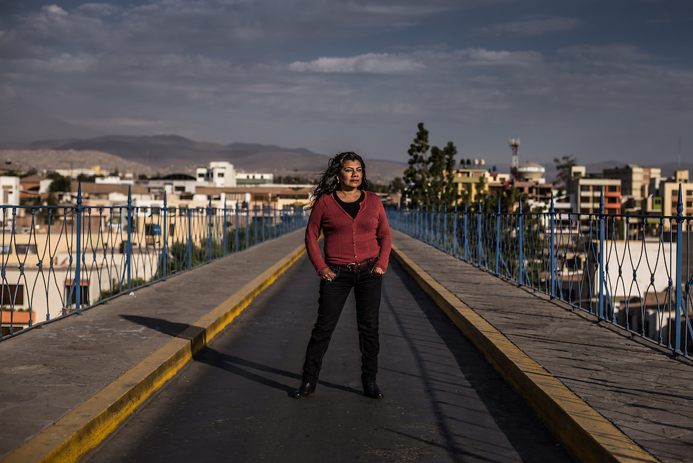 "AREQUIPA, PERU - OCTOBER 11, 2014: ""Anything made of metal in South America, people say it is by Eiffel,"" said Darci Gutiérrez, a professor of architecture here in Arequipa, Peru's second largest city, who has spent years debunking what she calls the Eiffel myth. She is posing for a portrait on the Iron Bridge in Arequipa, one of the most notable structures claimed to be built by Eiffel in Peru, that her research proved indeed was not built by him.  CREDIT: Meridith Kohut for The New York Times"