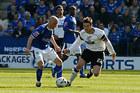 Photo: Steve Bond.<br />Leicester City v Derby County. Coca Cola Championship. 06/04/2007. Richard Stearman (L) holds the ball from Matt Oakley (R)