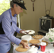 Elsie Stahl selects a dessert in the clubhouse before the finals of the 41st Weston Memorial Tennis Tournament at the Virginia Hollinger Memorial Tennis Club, Monday, May 26, 2008.