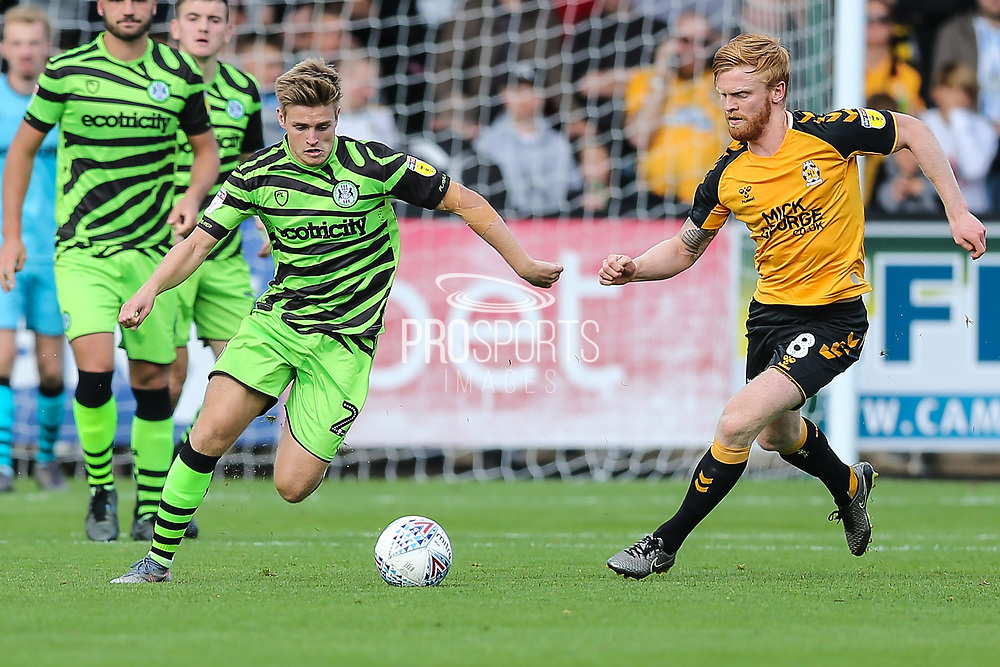 Forest Green Rovers Kyle Taylor(28),on loan from Bournemouth and Cambridge United's Liam O'Neil(8) during the EFL Sky Bet League 2 match between Cambridge United and Forest Green Rovers at the Cambs Glass Stadium, Cambridge, England on 7 September 2019.