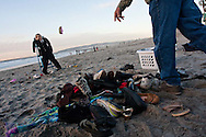 Opponents of the outgoing President hurled shoes at an effigy of George W. Bush on the beach at Newport Ave. in Ocean Beach, San Diego.  The event was hosted by a performance group called the Ground Zero Players.