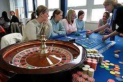 UK ENGLAND LANCASHIRE BLACKPOOL 1DEC04 - Blackpool College students Kelly Brophy, Stacy Wigley, Kristina Rowlands and Laura Croft (L-R) watch croupier Kyla Black (R) place their bets on the Roulette table as part of their croupier course. As part of proactive preparation for the hoped-for arrival of the 'Super-Casinos', Blackpool College has initiated croupier courses to fill the anticipated future gap in the local labour market.....jre/Photo by Jiri Rezac....© Jiri Rezac 2004....Contact: +44 (0) 7050 110 417..Mobile:  +44 (0) 7801 337 683..Office:  +44 (0) 20 8968 9635....Email:   jiri@jirirezac.com..Web:    www.jirirezac.com....© All images Jiri Rezac 2004 - All rights reserved.