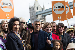 © Licensed to London News Pictures. 05/03/2017. LONDON, UK.  Celebrities and feminist activists, including Annie Lennox, Bianca Jagger with Mayor of London, Sadiq Khan take part in the March4Women, organised by CARE International to mark International Women's Day. The Women's Day March begins at The Scoop near City Hall, before proceeding over Tower Bridge and finishing at the Tower of London. Photo credit: Vickie Flores/LNP