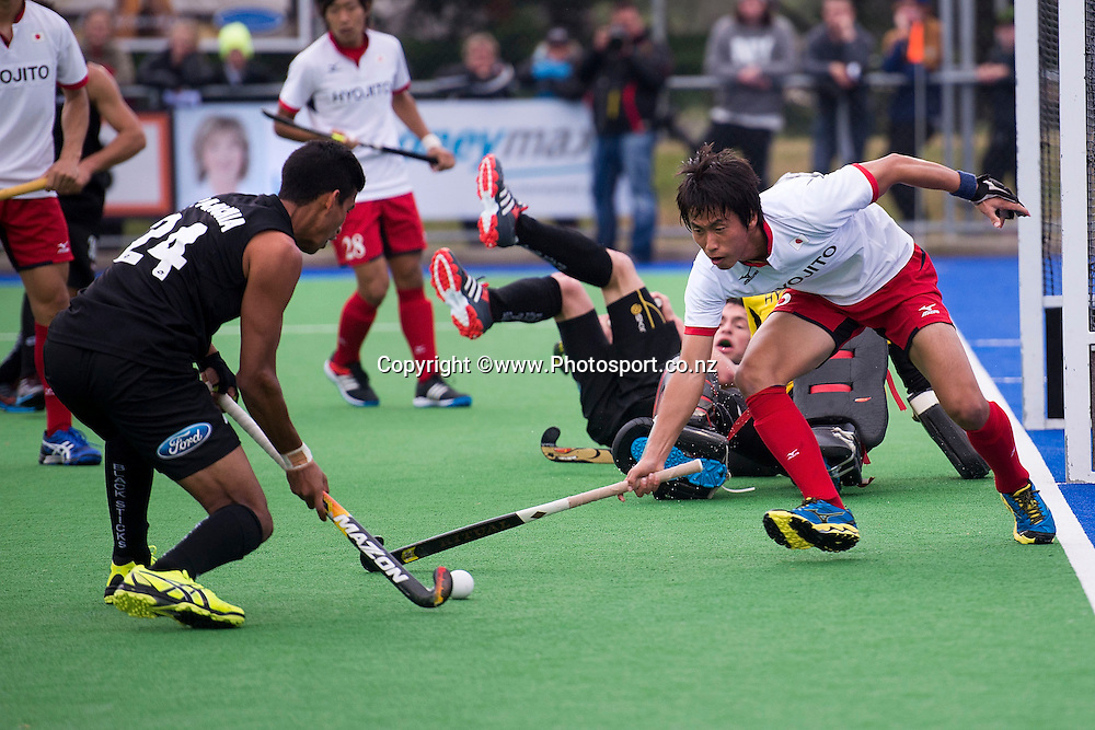 Naoto Shiokawa (R of Japan tackles Arun Panchia of New Zealand during the Black Sticks Men v Japan international hockey match at the Coastlands Kapiti Sports Turf in Paraparaumu on Friday the 22nd of November 2014. Photo by Marty Melville/www.Photosport.co.nz