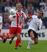Fotball<br /> 20.07.2004<br /> Premier League<br /> Foto: SBI/Digitalsport<br /> NORWAY ONLY<br /> <br /> Stevenage Borough v Tottenham Hotspur. Pre season friendly.  20/7/04<br /> <br /> Stevenage Borough's Dannie Bulman and Tottenham Hotspur's Pedro Mendes