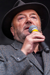 © Licensed to London News Pictures. 21/03/2015. Trafalgar Square, London UK. George Galloway MP, on stage addressing the large crowds assembled in Trafalgar Square for the Stand Up to Racism and Fascism rally. Photo credit : Stephen Chung/LNP